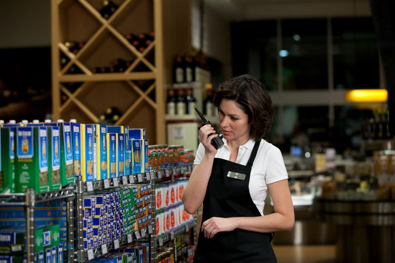 retail worker using two-way radio