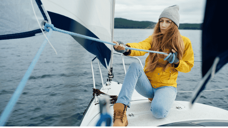 Female sailor on water
